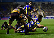 Warrington Wolves MATTY RUSSEL dives over in the corner for his sides third try during the Dacia World Club Series match Warrington Wolves -V- Brisbane Broncos at Halliwell Jones Stadium , Warrington, Cheshire, England on February 18, 2017. (Steve Flynn/Image of Sport)