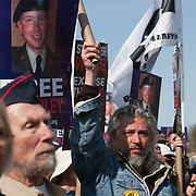 Supporters of Bradley Manning protest his imprisonment near Quantico Marine Corps base, March 20, 2011. More than two dozen people were arrested during the protest, including Daniel Ellsberg, a former military analyst. The arrests came at the end of a largely peaceful demonstration.