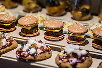 DUBAI, UAE - DECEMBER 18, 2015: Burger-like macaroons are part of the desert buffet at the Arboretum restaurant, located in Jumeirah Al Qasr, Madinat Jumeirah Resort.