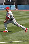 LOS ANGELES, CA - AUGUST 10:  Chase Utley #26 of the Philadelphia Phillies stretches before the game against the Los Angeles Dodgers on August 10, 2011 at Dodger Stadium in Los Angeles, California. The Phillies won the game 9-8. (Photo by Paul Spinelli/MLB Photos via Getty Images) *** Local Caption *** Chase Utley