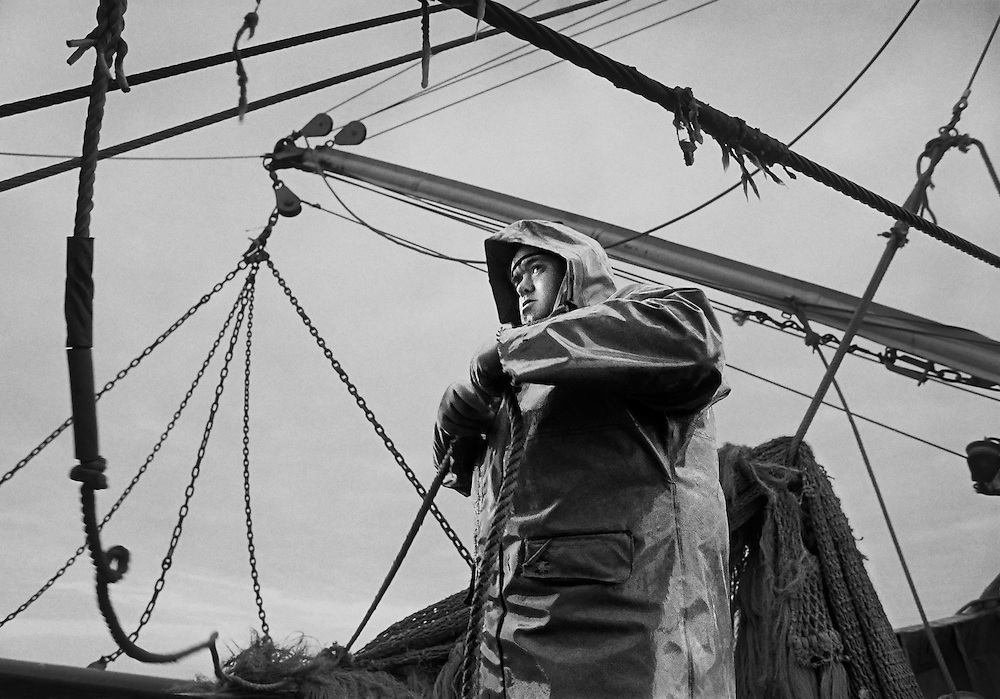 Malcolm Smitheram, deckhand and cook, securing the nets, on PZ 198, the 'Aaltje Adriaantje', working out of Newlyn, Cornwall, England.<br /> <br /> The Aaltje Adriaantje is a 29m. long beam trawler and part of Europe's largest privately owned fishing fleet, owned by W. Stevenson &amp; Son. The company has been a leader in the British fishing industry for more than a hundred years.<br /> <br /> In the 1990s, W. Stevenson and Son had a fleet of 35 vessels, manned by 150 self-employed share fishermen.  They also had around 60 shore staff that were involved in landing the fish, selling them at auction and dispatching them across the UK and Europe.<br /> <br /> Currently the fleet has been reduced to approximately 20 fishing boats, mainly beam trawlers, as the industry has been hit particularly badly by the steep rise in the price of fuel.