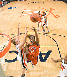 Clemson forward Jasmine Tate (24) shoots over Virginia forward Kelly Hartig (42).  The Virginia Cavaliers women's basketball team defeated the Clemson Tigers 83-71 at the John Paul Jones Arena in Charlottesville, VA on February 21, 2008.