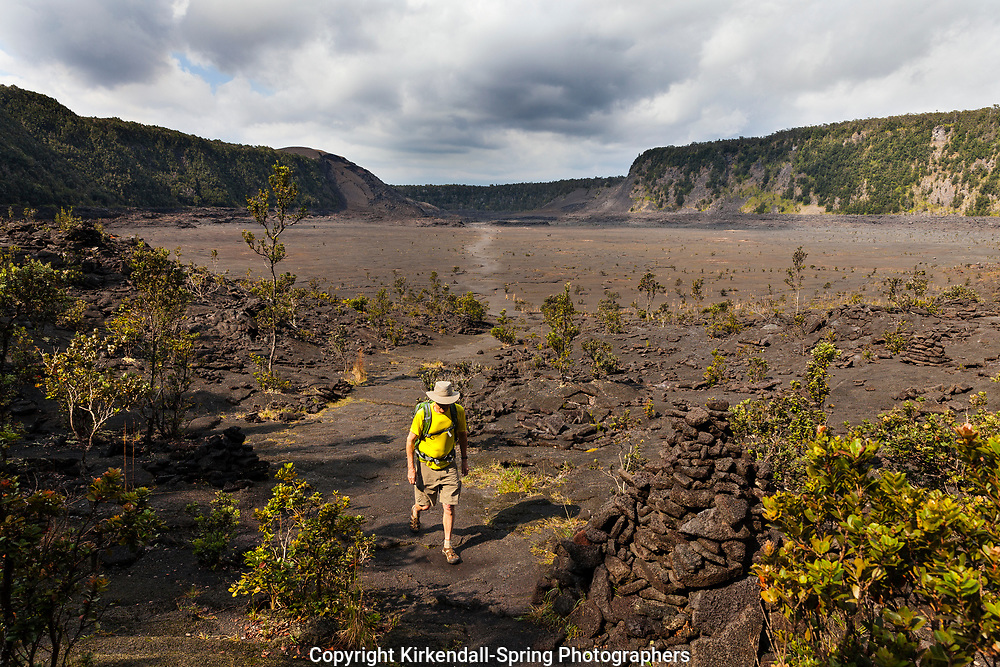 HI00374-00...HAWAI'I - Hiker crossing the Kilauea Iki Crater in Hawai'i Volcanoes National Park. (MR# V2)