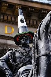 Glasgow, Scotland, UK. 12 June 2020. Famous statue of Duke of Wellington with traffic cone on his head . This time the traffic cone is replaced with a black one representing Black Lives Matter protest movement. Iain Masterton/Alamy Live News