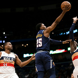 Jan 30, 2019; New Orleans, LA, USA; Denver Nuggets guard Malik Beasley (25) shoots over New Orleans Pelicans forward Darius Miller (21) and forward Cheick Diallo (13) during the first quarter at the Smoothie King Center. Mandatory Credit: Derick E. Hingle-USA TODAY Sports