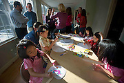 Families celebrate the Chinese Lunar New Year at the Dominion Hills Area Recreation Association in Arlington, Virginia.  Photography by Johnny Bivera