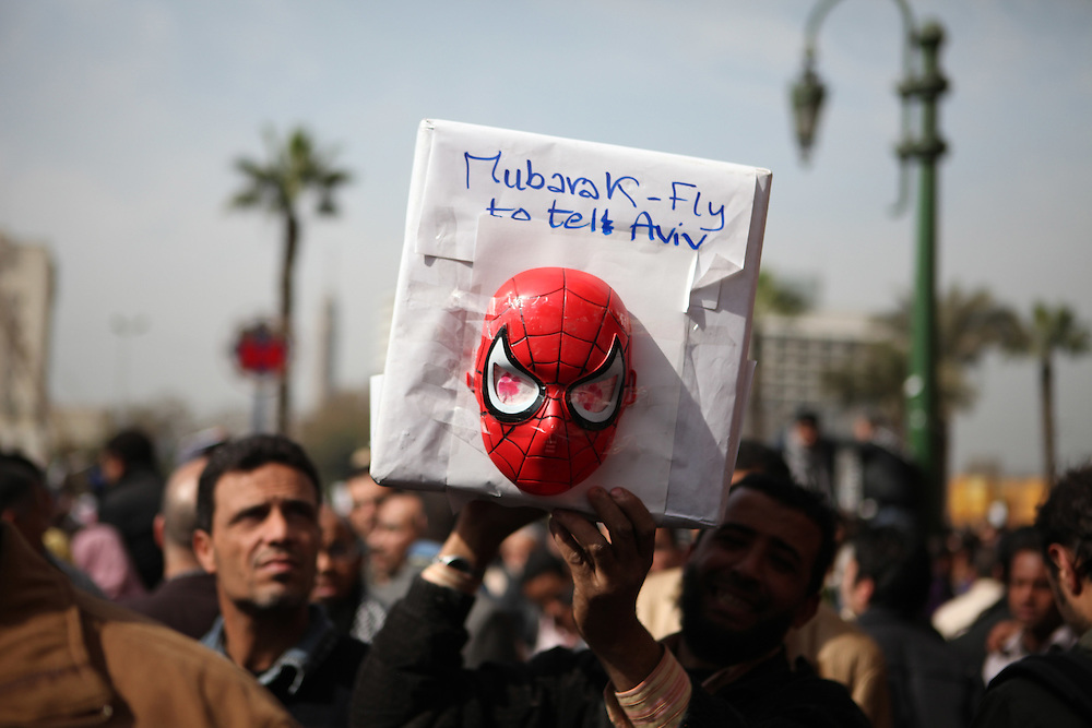 A protester holds a sign telling Mubarak to fly to Tel Aviv. Mubarak is a close ally of the US and Israel. .