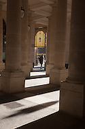 France. Pariis, 1st district ,  Royal palace Garden, pedestrians shadows under the arches  / Jardin du palais royal