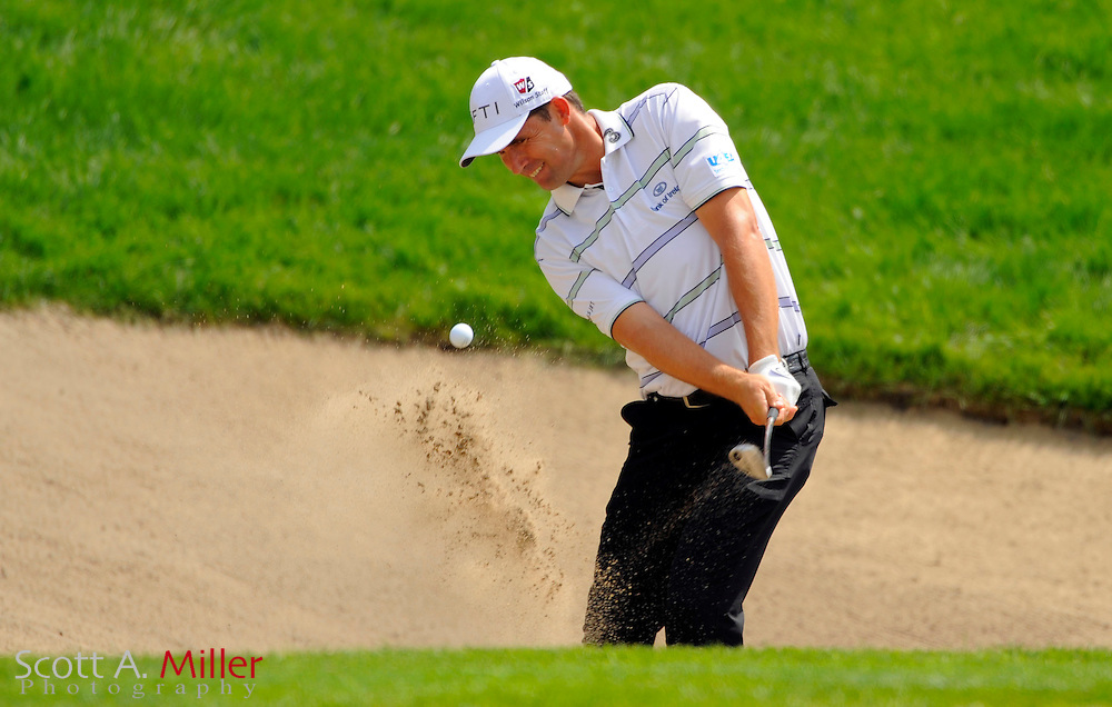 Aug 13, 2009; Chaska, MN, USA; Padraig Harrington (IRL) hits out of a bunker on the 7th hole during the first round of the 2009 PGA Championship at Hazeltine National Golf Club.  ©2009 Scott A. Miller
