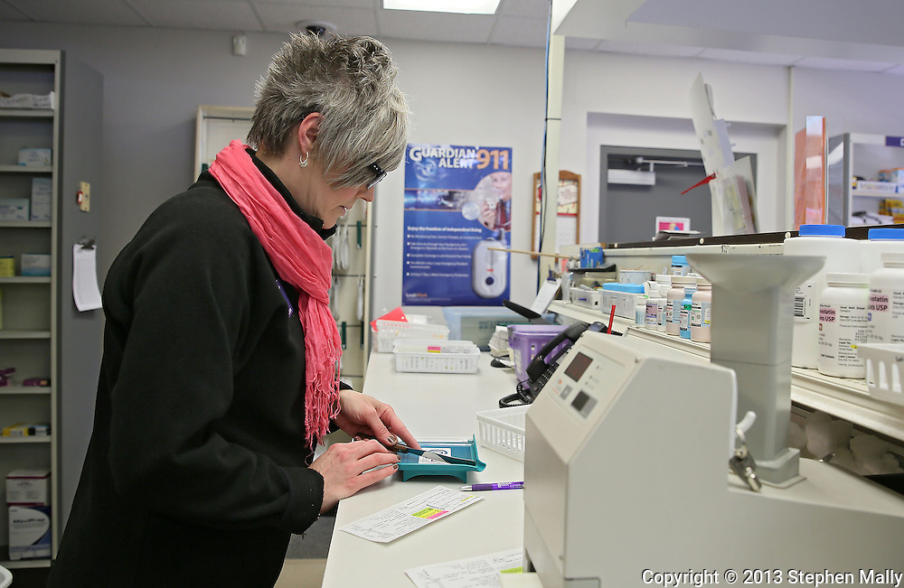 Shari Bedard, Certified Pharmacy Technician, counts out pills while she fills a prescription at Medicap Pharmacy in Cedar Rapids on Tuesday, March 19, 2013.