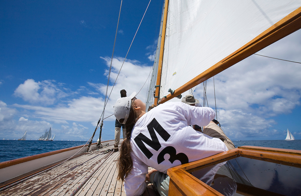 A crew member looks up at the mainsail on board SY Galatea during the 2008 Antigua Classic Yacht Regatta . This race is one of the worlds most prestigious traditional yacht races. It takes place annually off the coast of Antigua in the British West Indies.
