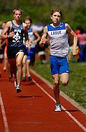 9 APRIL 2011 -- UNIVERSITY CITY, Mo. -- Ladue High School distance runner Drew Padgett (right) duels SLU High School's Tim Rackers during the boys' 1600 meter run at the Charlie Beck Invitational track meet at University City High School in University City, Mo. Saturday, April 9, 2011. Padgett won the event. Image (c) copyright 2011 Sid Hastings.
