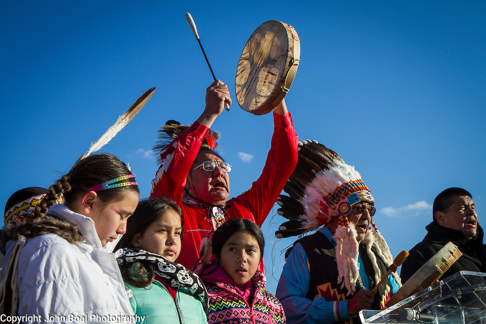 Dennis Zotigh, Kiowa, and his father, Ralph, sings and drums along with family during a protest and march from in front of the U.S. Capitol to the EPA, about the North Dakota Access Pipeline, as well as the effort to free Leonard Peltier.  Saturday, December 10, 2016. John Boal Photography