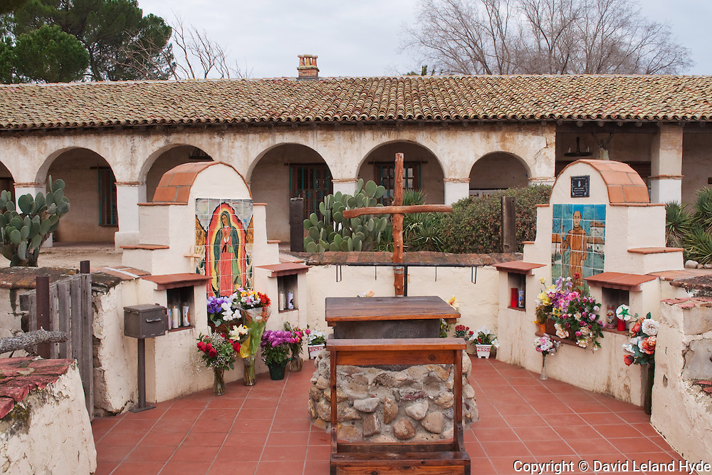 Outdoor Alter, Mission San Miguel De Archangel, San Luis Obispo County, Central Coast, California Missions, Catholic Church, Hispanic culture, wooden cross, portico, colonnade, archways, Virgin Mary, Flowers, St. Francis of Asisi, Archangel Michael, adobe, terracotta tiles, copyright 2010 by David Leland Hyde. Nikon D90.