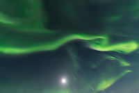 In mid-latitudes I always consider bright moonlight as an obstacle to seeing the aurora. But in the Arctic the aurora is so bright that I can use a short exposure, and including the moon in the shot is not an issue.