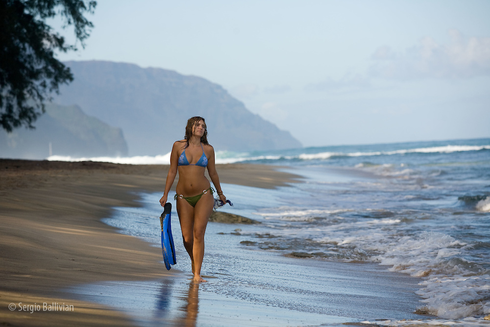 Young woman snorkeling off the island of Kauai, Hawaii