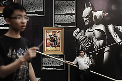 Security stand in front of Batman history board during the exhibition in conjunction with Batman's 75th anniversary in a shopping mall in Kuala Lumpur on Jun 02, 2014. The Batman 75th Anniversary celebration Malaysia is from 28 May 2014 & will run till 15 June 2014, Monday, 2nd June 2014. Picture by Mohd FIrdaus / i-Images