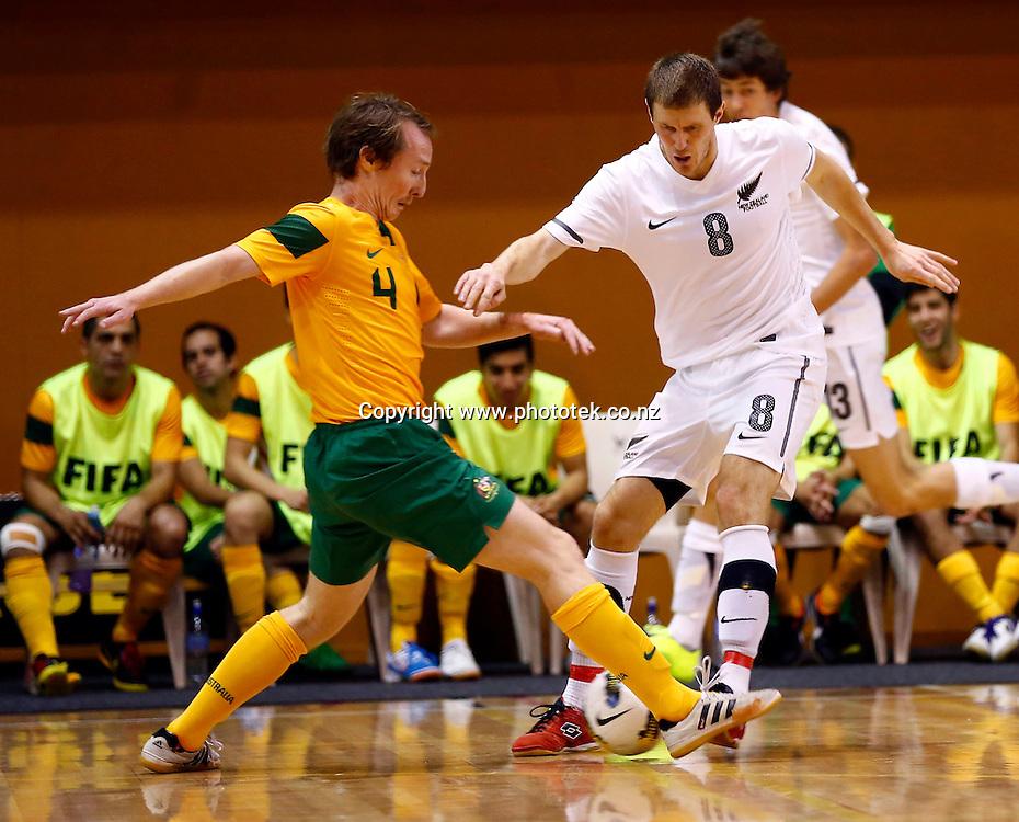 Futsal Whites Daniel Burns tangles with Futsal Roos Dean Lockheart. ASB Trans Tasman Cup, Futsal Whites v Futsal Roos, ASB Stadium, Kohimarama, Friday 21st September 2012. Photo: Shane Wenzlick
