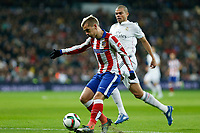 Real Madrid´s Pepe (R) and Atletico de Madrid´s Griezmann during Spanish King´s Cup match at Santiago Bernabeu stadium in Madrid, Spain. January 15, 2015. (ALTERPHOTOS/Victor Blanco)