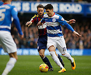 Queens Park Rangers midfielder Alejandro Faurlín keeps the ball from Ipswich Town midfielder Cole Skuse during the Sky Bet Championship match between Queens Park Rangers and Ipswich Town at the Loftus Road Stadium, London, England on 6 February 2016. Photo by Andy Walter.