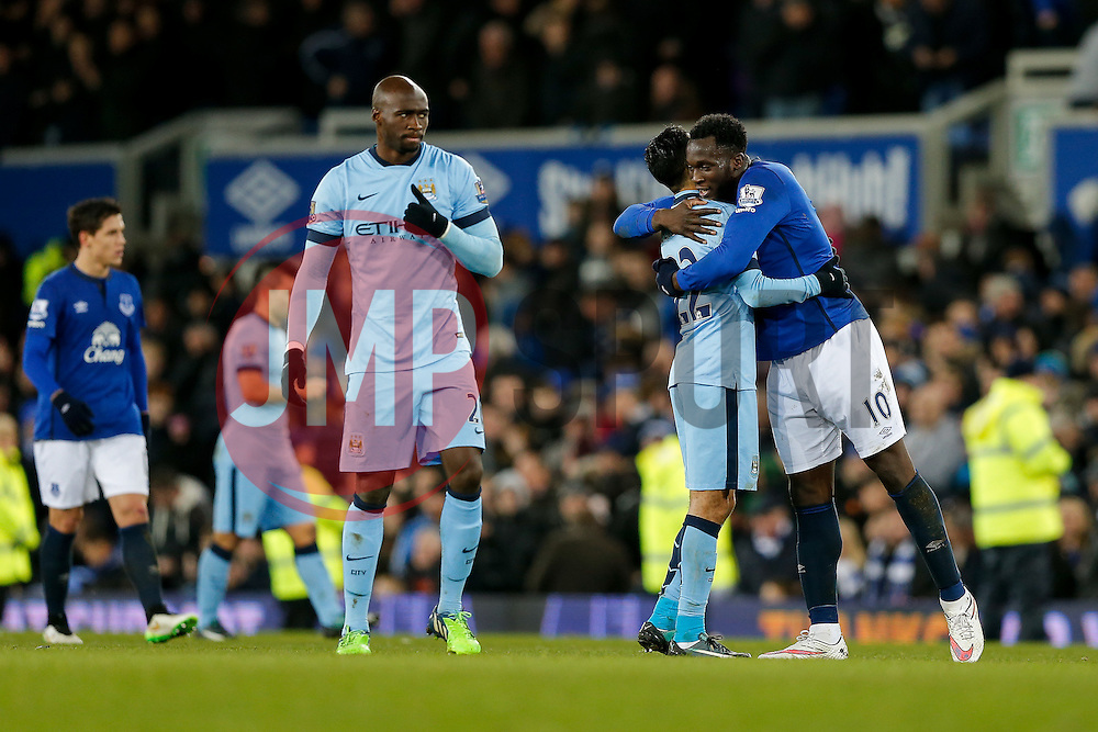 Gael Clichy of Manchester City and Romelu Lukaku of Everton hug after the match ends in a 1-1 draw - Photo mandatory by-line: Rogan Thomson/JMP - 07966 386802 - 10/01/2015 - SPORT - FOOTBALL - Liverpool, England - Goodison Park - Everton v Manchester City - Barclays Premier League.