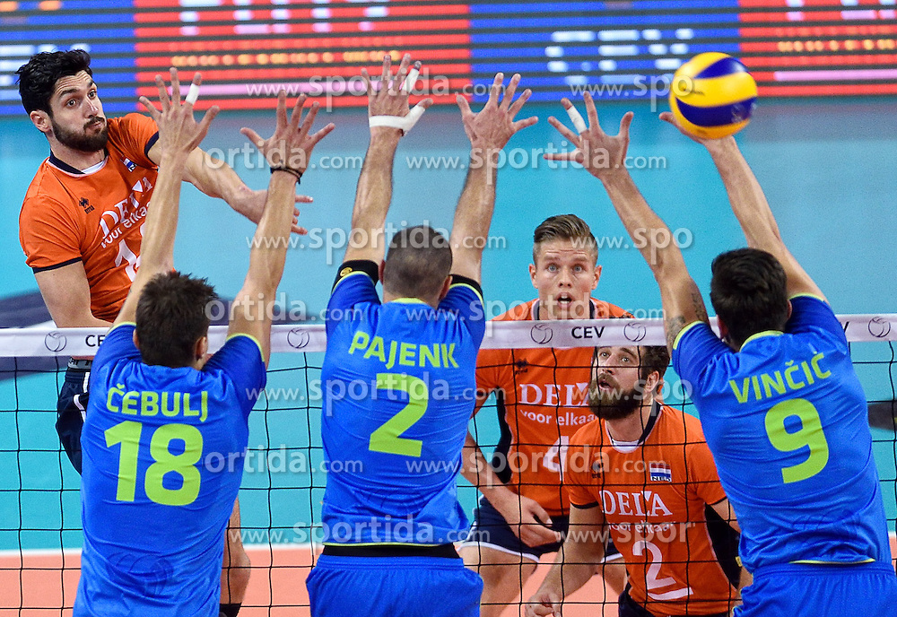 Niels Klapwijk #14, Klemen Cebulj, Alen Pajenk and Dejan Vincic during volleyball match between National teams of Netherlands and Slovenia in Playoff of 2015 CEV Volleyball European Championship - Men, on October 13, 2015 in Arena Armeec, Sofia, Bulgaria. Photo by Ronald Hoogendoorn / Sportida