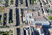 Nederland, Noord-Holland, Amsterdam, 27-09-2015; stadsdeel Amsterdam-West (Kinkerbuurt). Cultureel centrum De Hallen, met onder andere bibliotheek, theater, bioscoop de Filmhallen. Voormalige Remise Tollensstraat. Andere straten onder andere Kinkerstraat, Bilderdijkkade, Bellamyplein en Ten Katestraat. <br /> Cultural center De Hallen, including library, theater, cinema. Former tram shed.<br /> <br /> luchtfoto (toeslag op standard tarieven);<br /> aerial photo (additional fee required);<br /> copyright foto/photo Siebe Swart
