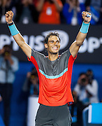 Rafael Nadal of Spain celebrates his semifinal victory in the Australian Open against Roger Federer of Switzerland. Nadal faces S. Wawrinka of Switzerland in Sunday's finals.The match was held at Melbourne's Rod Laver Arena.
