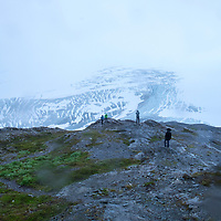 Hikers snap photos after reaching the peak of the Harding Icefield trail at the Kenai Fjords National Park in Seward, Alaska, on Thursday, August 4, 2016. (Alex Menendez via AP)