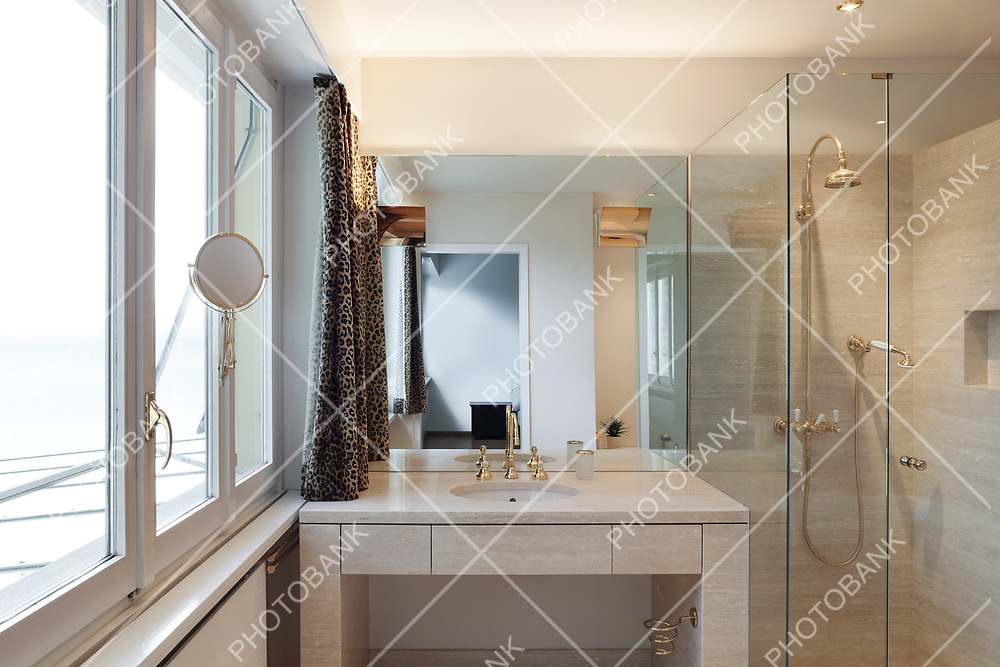 Interior, modern bathroom of an house, shower and sink