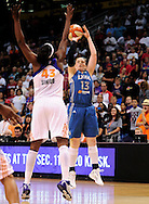 Sep 11, 2011; Phoenix, AZ, USA; Minnesota Lynx guard Lindsay Whalen puts up a shot against the Phoenix Mercury forward Nakia Sanford (43) during the first half at the US Airways Center.  The Lynx defeated the Mercury 96-90. Mandatory Credit: Jennifer Stewart-US PRESSWIRE