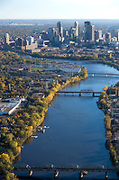 Mississippi river leads the eye towards the skyline of Minneapolis, Minnesota, USA.