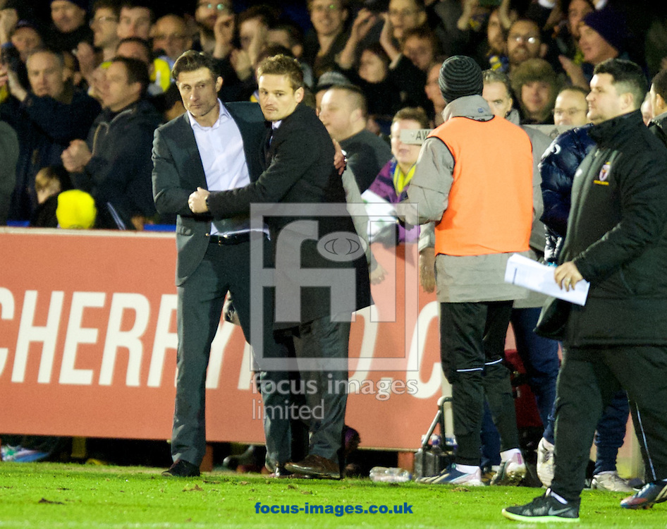 Picture by Alan Stanford/Focus Images Ltd +44 7915 056117<br /> 11/01/2014<br /> Manager Neal Ardley of AFC Wimbledon and  Manager Chris Hargreaves (L) of Torquay United at the end of the Sky Bet League 2 match at the Cherry Red Records Stadium, Kingston.