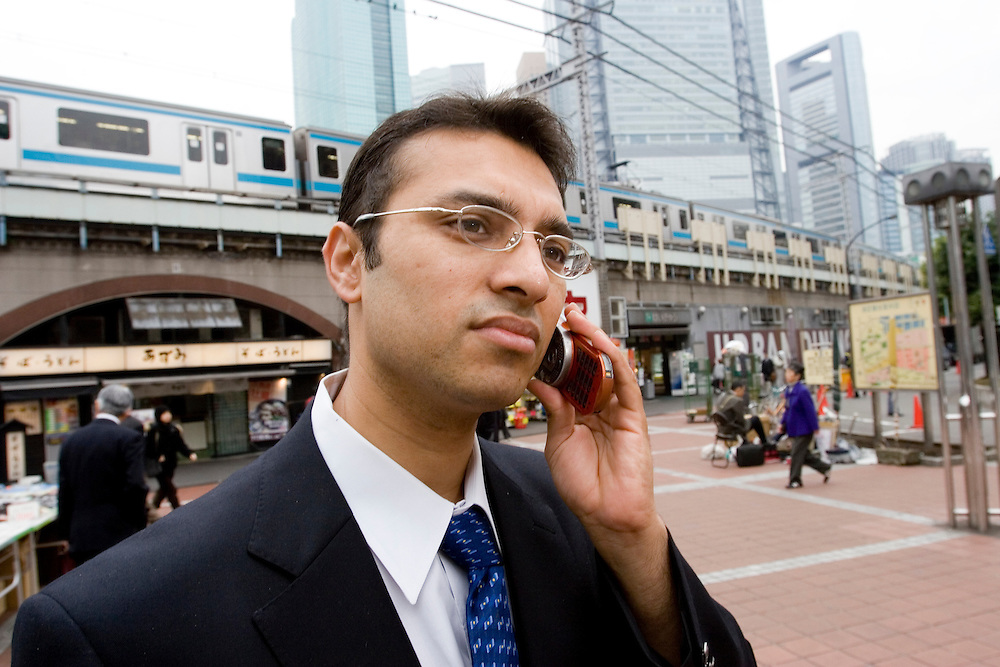 Sunil Kulkarni  photographed  in down town tokyo  Shinabashi and near Nihonbashi meets  with Japanes  client  Mr. Kiriyama Yasuiro Of  IT  firm that deals with  Stock market reporting  (www.stockweather.co.jp)