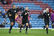 Referee Kevin Friend  and Referee Assistants Matthew Wilkes, Simon Beck warming up during the Premier League match between Burnley and West Ham United at Turf Moor, Burnley, England on 9 November 2019.