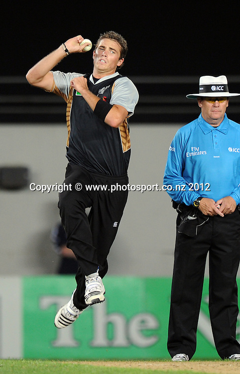 Tim Southee bowling as umpire Gary Baxter looks on during the 3rd and final InternationaI Twenty20 cricket match between New Zealand Black Caps and South Africa at Seddon Park, Hamilton, New Zealand on Wednesday 22 February 2012. Photo: Andrew Cornaga/Photosport.co.nz