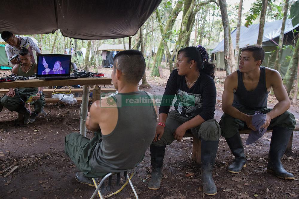 El Diamante, Meta, Colombia - 18.09.2016        <br /> <br /> FARC fighter watching cartoons in a guerilla camp during the 10th conference of the marxist FARC-EP in El Diamante, a Guerilla controlled area in the Colombian district Meta. Few days ahead of the peace contract passing after 52 years of war with the Colombian Governement wants the FARC decide on the 7-days long conferce their transformation into a unarmed political organization. <br /> <br /> FARC Kaempfer sehen sich Zeichentrickfilme im Guerilla-Camp an, am Rande der zehnten Konferenz der marxistischen FARC-EP in El Diamante, einem von der Guerilla kontrollierten Gebiet in der kolumbianischen Region Meta. Wenige Tage vor der geplanten Verabschiedung eines Friedensvertrags nach 52 Jahren Krieg mit der kolumbianischen Regierung will die FARC auf ihrer sieben taegigen Konferenz die Umwandlung in eine unbewaffneten politischen Organisation beschlieflen. <br />  <br /> Photo: Bjoern Kietzmann