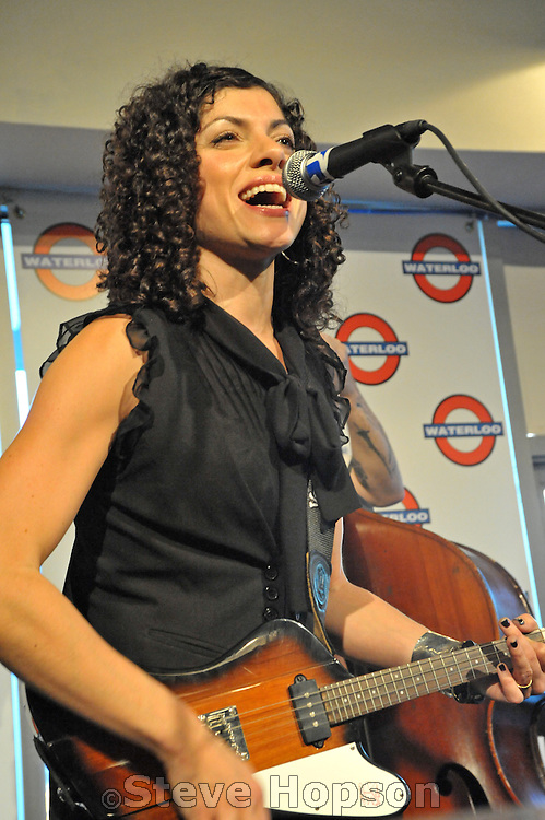 "Carrie Rodriguez performing at Waterloo Records, Austin Texas, October 23 2008. Carrie Rodriguez (born 1978) is an American singer-songwriter and the daughter of Texan singer-songwriter David Rodriguez. She was discovered by Chip Taylor at the South by Southwest music festival in 2001. Rodriguez released her solo album, ""Seven Angels on a Bicycle"", in 2006 and ""She Ain't Me"" in 2008."