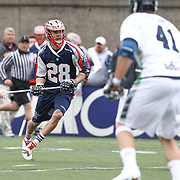 Brent Adams #28 of the Boston Cannons runs with the ball during the game at Harvard Stadium on April 27, 2014 in Boston, Massachusetts. (Photo by Elan Kawesch)