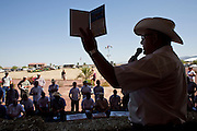 31 JULY 2009 --  BUCKEYE, AZ: Auctioneer Peter Belezzuoli (CQ) from Overland Stockyards in Hanford, CA, works at the auction on the former Pylman Dairy Farm in Buckeye. The auction was handled by Overland Stockyards from Hanford, CA. The Arizona dairy industry is struggling to survive the worst milk economy some have ever seen. Due to the global recession, overseas demand for Arizona dairy products has plummeted, forcing prices down while production costs have stayed stable or gone up. For every $1 dairymen earn from milk sales, it cost them $1.50 to produce the milk. Photo by Jack Kurtz