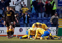 Photo. Glyn Thomas.<br /> Mansfield Town v Hull City.<br /> Nationwide League Division 3.<br /> Field Mill, Mansfield. 06/03/2004.<br /> Mansfield Town's Laurent D'Jeffo is mobbed by teammates after scoring the winning goal as Hull players can only look on dejectedly.