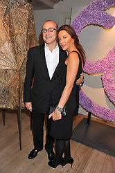 PAUL McKENNA and SAMANTHA WICKENS at a reception to celebrate the publication of Candy and Candy: The Art of Design held at the Halcyon Gallery, 24 Bruton Street, London W1 on 26th October 2011.