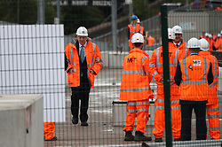 © Licensed to London News Pictures. 27/07/2019. Manchester, UK. British Prime Minister Boris Johnson visits an under construction area of the Trafford Line extension by Manchester's Pomona Metrolink tram stop during a visit to the city . Johnson will re-announce the HS3 rail link between Manchester and Leeds at a speech in Manchester City Centre today . Photo credit: Joel Goodman/LNP