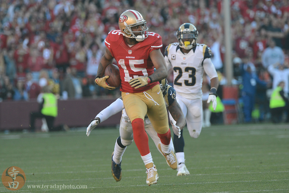 December 1, 2013; San Francisco, CA, USA; San Francisco 49ers wide receiver Michael Crabtree (15) runs with the ball against St. Louis Rams free safety Rodney McLeod (23) during the third quarter at Candlestick Park. The 49ers defeated the Rams 23-13.