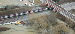 © Licensed to London News Pictures. 09/01/2014. Oxford, UK. A train on flooded railway tracks at Hinksey. Flooding in Oxford today 9th January 2014. Persistent rainfall across the UK, including in Oxford, has led to rising water levels on rivers. Photo credit : Air Experiences/LNP