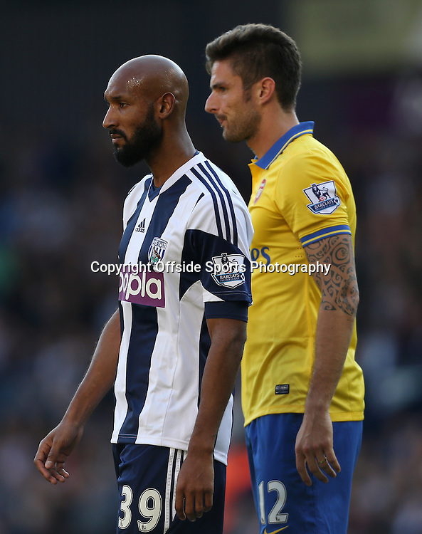 6th October 2013 - Barclays Premier League - West Bromwich Albion v Arsenal - Nicolas Anelka of West Brom and Olivier Giroud of Arsenal - Photo: Simon Stacpoole / Offside.
