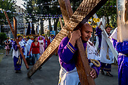 Catholic devotees dressed as Nazarenes begin the Passion of the Christ procession in Iztalapala dragging 100kg (220 lb.) crosses behind them for the long walk to the summit of Cerro de Estrella.