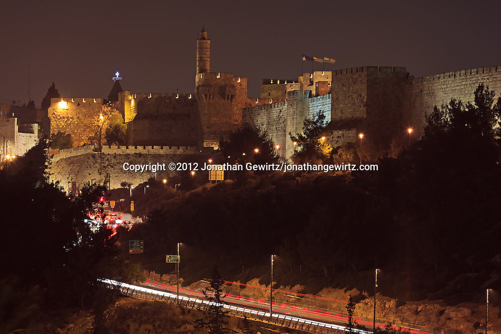 Night traffic on Hativat Yerushalayim and Jaffa Street passes the Sultan's Pool and Citadel of David on the way to the Jaffa Gate in Jerusalem's Old City. WATERMARKS WILL NOT APPEAR ON PRINTS OR LICENSED IMAGES.