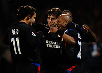 Photo: Daniel Hambury.<br />Lyon v PSV Eindhoven. UEFA Champions League. 08/03/2006.<br />Lyon's Sylvain Wiltord celebrates his goal with team mates.