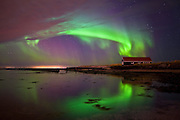 A Boathouse Encirled by Aurora Borealis, Reykjavík Iceland